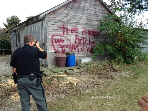 IMG_3650sgnd Sept 21, 2017 Deputy Hildreth capturing the graffiti Cornerstone church did to our barn